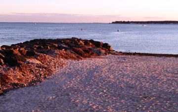 Fall is the perfect time to take a solitary beach walk in the purplish twilight.